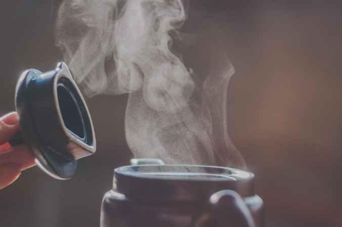 selective focus photography of jar releasing smoke